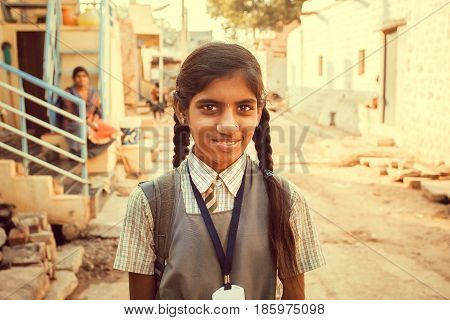BADAMI, INDIA - FEB 8, 2017: Unidentified Indian schoolgirl having fun outdoor in small asian village on February 8, 2017. Population of Karnataka state is 62000000 people