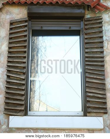 Plastic window with vintage shutters