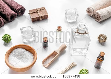 spa composition for body care with sea salt on white table background