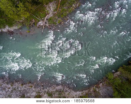 Aerial view of rapids on a raging river.
