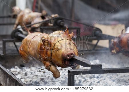 Traditionally Suckling Pig On A Rotating Spit