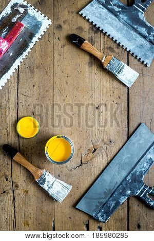 building implements set for house repair on wooden desk background top view mock up