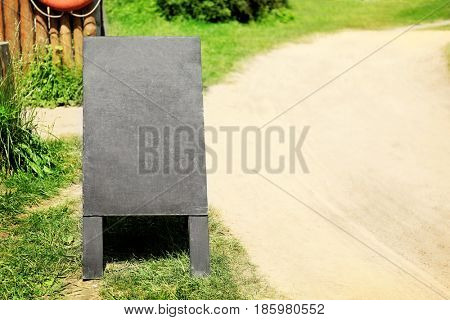 Wooden whiteboard advertising outdoor