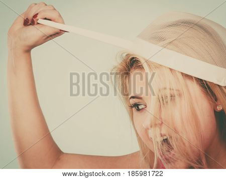 Baking cooking meal and food concept. Woman wearing colander on head as hat about to cook something