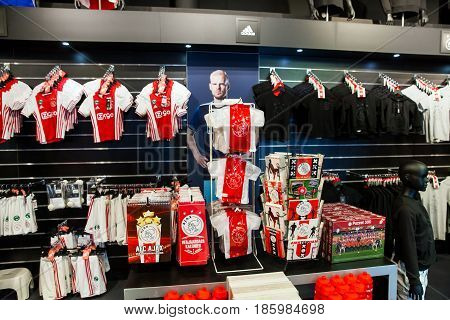 Amsterdam, Netherlands - April, 2017: Ajax fotball club fan shop interior on Amsterdam Arena, Netherlands