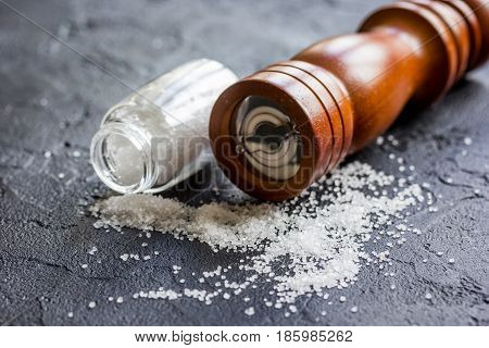 Cooking set with salt and saltcellar on kitchen dark table background