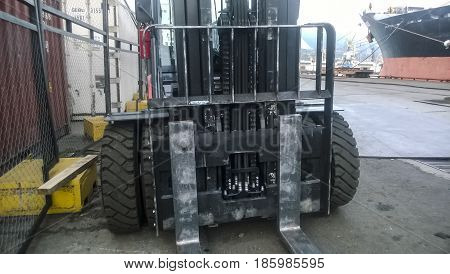 Forklift Truck In The Industrial Cargo Port. Service Vehicles