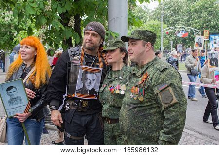 Donetsk Ukraine - May 09 2017: Famous Russian biker Alexander Zaldostanov is photographed with citizens of Donetsk on the march in honor of the anniversary of victory in the Second World War