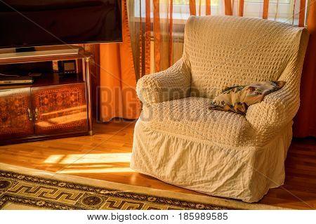 Comfortable armchair in cozy living room near TV set