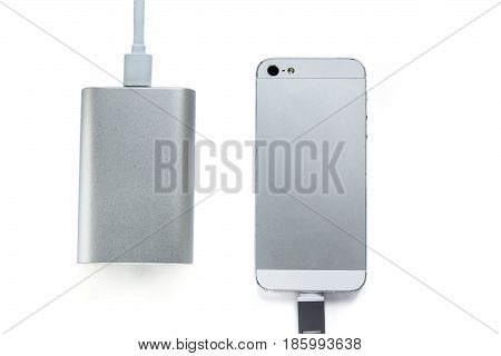 Smartphone Charging With Portable External Battery ( Power Bank ) Isolated On A White Background