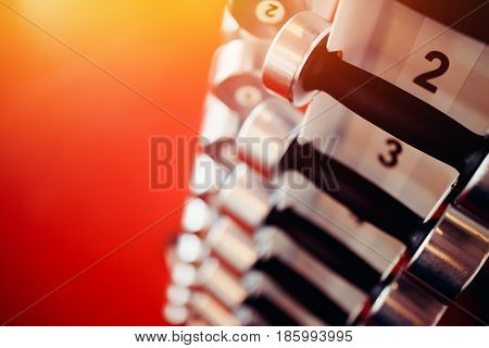 Sports equipment dumbbell rests in a row