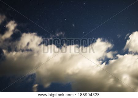 Night sky with clouds and stars. Photos endurance