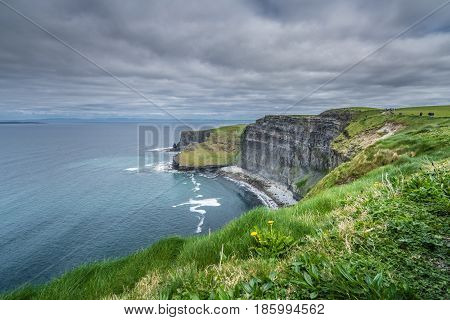 View over Cliffs of Moher on a overcast, cloudy and gloomy day, Ireland