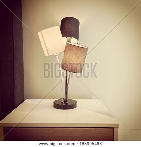 Retro style lamp on a dresser. Home decor.