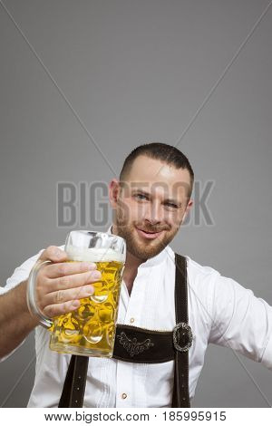 An image of a young bavarian with a beer