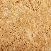 Close-up crop fragment of a halva's confections surface as a backdrop texture poster