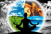 Female yoga figure in a transparent sphere composed of four natural elements (water fire earth air) as a concept for controlling emotions power over nature calm and optimism. poster