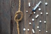 Concept Stop drugs: a syringe pills and a rope with a knot on a wooden background. No drugs or anti doping in sport or zero tolerance to drugs. Drugs pills top view flat lay. poster