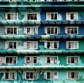 Group of windows at facade building in green on day this highrise building is student dormitory at Ho Chi Minh city Vietnam poster
