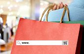 Word www. on search bar over red shopping bag and blur store background online shopping background business E-commerce web banner poster