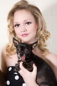 Blond beautiful woman with her little dog poster