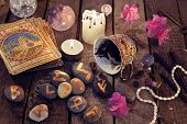 Divination rite with coffee and stone runes. Halloween background, coffee and tarot cards reading ritual, occult and esoteric objects on witch table poster