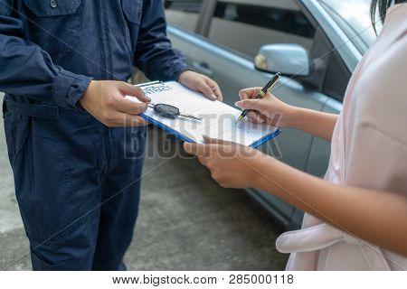 Technicisn Repairman Giving Car Key To Woman In Workshop Workshop Mechanic Repair Client Car In Aut