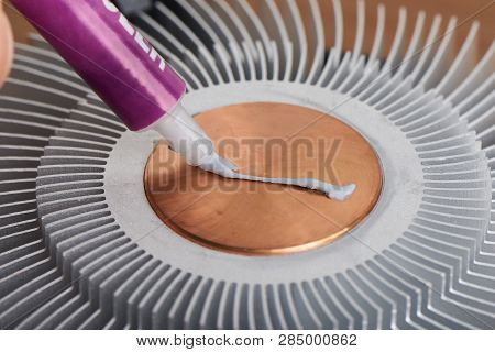 Applying Thermal Paste To The Surface Of Heat Sink