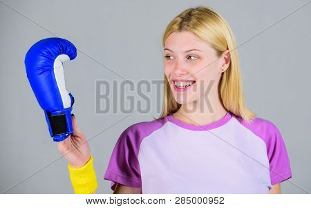 Cardio boxing exercises to lose weight. Girl learn how defend herself. Femininity and strength balance. Woman boxing gloves enjoy workout. Boxing sport concept. Woman exercising with boxing gloves poster