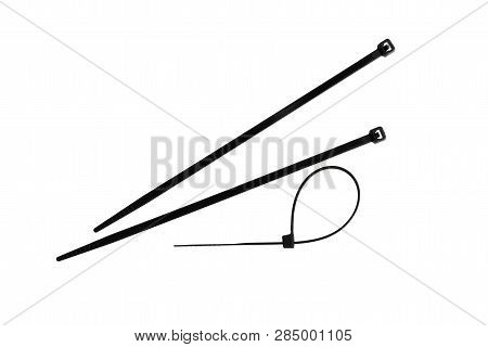 Close-up Of Cable Ties And A Locked Cable Tie, Isolated On White Background