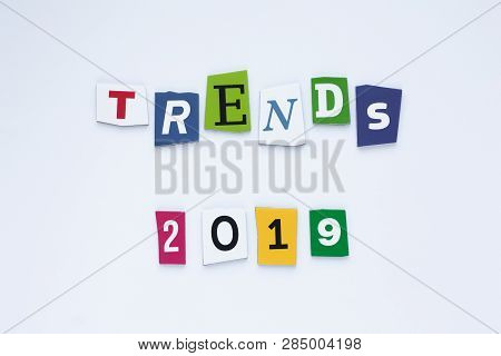 The Word Trends On Colored Letters. Trends Concept. Inscription Trends 2019. Abstract Card With Colo