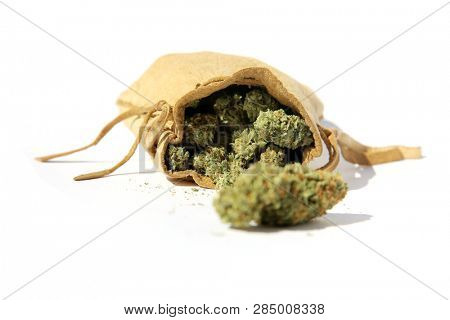 Marijuana. Recreational or Medical Marijuana or Cannabis in a Leather Bag. Isolated on white. Room for text.