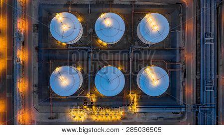 Petrochemical Industrial, Gas Storage Tank Oil Storage Tank At Night, Aerial View Oil And Gas Storag