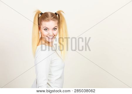 Education, Teenage Adolescence, Happiness Concept. Happy Blonde Teenager Student Girl With Ponytails