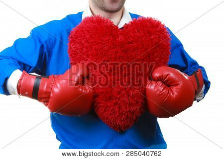 Guy Ready To Fight For Love. Adult Man Wearing Red Boxing Sporty Gloves Holding Heart Shape. Winning