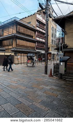 Kyoto, Japan - January 3, 2019 : A Typical Old Street With Traditional Japanese Houses With Pedestri