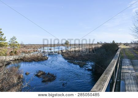 Wooden Footbridge By A Flooded Landscape By Spring Season At The Swedish Island Oland