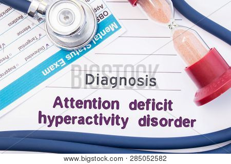Diagnosis Of Attention Deficit Hyperactivity Disorder (adhd). On Psychiatrist Table Is Paper With Ti