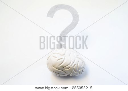 Question Mark Hangs Over 3d Model Of Brain. Concept Photo To Refer Difficult Issues, Problems, Solut