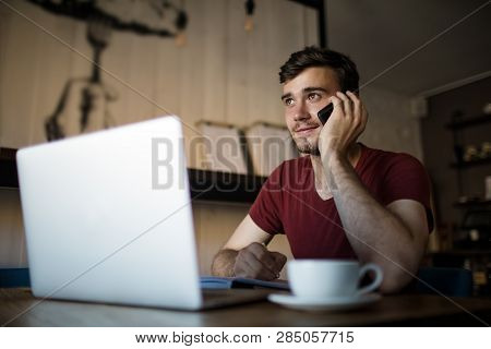 Young Man University Student Having Pleasant Cell Telephone Conversation During Online Learning On L