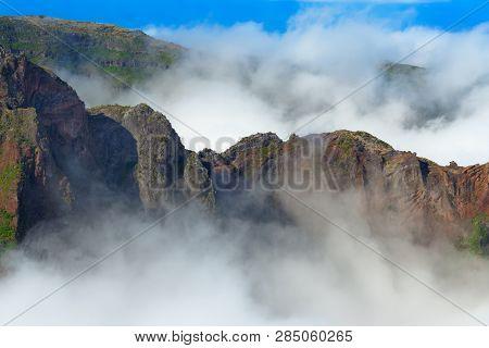 Mountain Range In Dense Clouds. View From Pico Do Arieiro On Portuguese Island Of Madeira