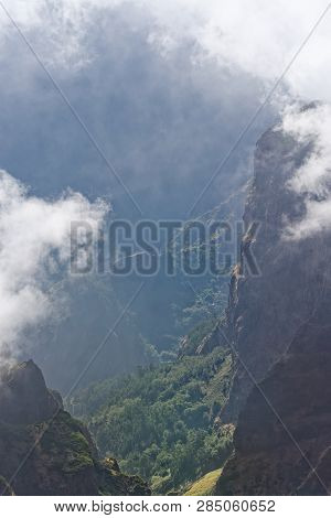 View Down From Mountain Peak At A Valley In Distant. Pico Do Arieiro On Portuguese Island Of Madeira