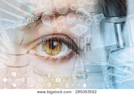 A Closeup Of A Female Eye Looking Straight Behind The System Of Laboratory Tools And Equipment Image