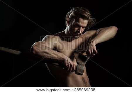 Naked Man. Good Looking Man Posing With Axe On Black Background. Perfect Muscular Body Of Young Male