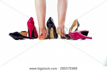 Feet in blood and uncomfortable heels on white background. Troubles with wearing high heels. Big bloody callus on womans heel close up. The terrible blister on female foot from heels poster