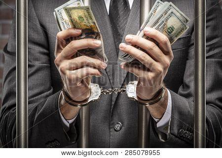 Corrupt Man Holding Bills Of Money