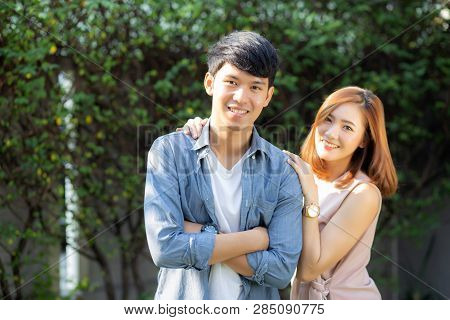 Beautiful Portrait Couple Looking Each Others Eyes And Smiling With Happy, Young Asian Man And Woman