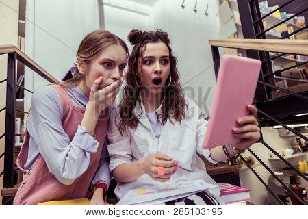Impressed Girls Being Terrified With Content On The Tablet