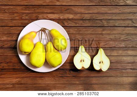 Fresh Pears And Half Pear. Yellow Pear On Wood Background. Pears Harvest. Fruit Background. Pear Hom