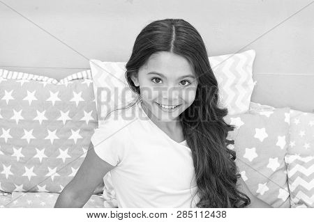 Childrens Tips And Techniques For Healthy Hair. Girl Cute Baby With Long Curly Hair Wear Pajamas. Ha